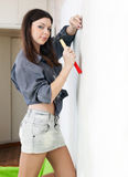 Young woman makes repairs Stock Photos