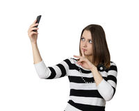 Young woman makes self shot. Modern gadgets and trends concept - Young pretty woman makes self shot isolated on white background Royalty Free Stock Photo