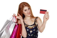 Young woman makes shopping with credit card Stock Images