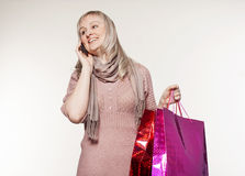 Young woman makes shopping and talking on the phone Stock Image