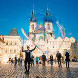 Young woman makes soap bubbles in Old Town Square in Prague, Czech Republic Stock Image