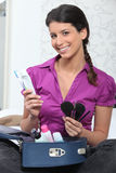 Young woman with a makeup bag Royalty Free Stock Photos