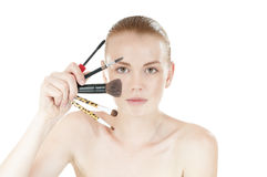 Young  woman with makeup brushes. Royalty Free Stock Images