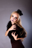 A young woman makeup for Halloween. A young woman dressed as a witch, makeup for Halloween Royalty Free Stock Image