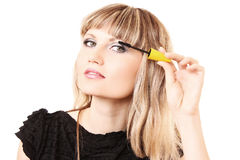 Young woman makeup with mascara isolated Stock Photo