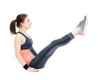 Young woman making abdominal exercises Stock Images