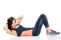 Young woman making abdominal exercises Royalty Free Stock Photo