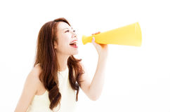 Young Woman making announcement with megaphone. Young asian Woman making announcement with megaphone Royalty Free Stock Photo