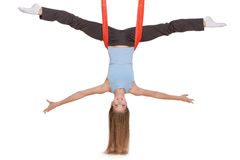 Young woman making antigravity yoga exercises in Stock Photos