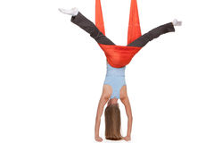 Young woman making antigravity yoga exercises in Royalty Free Stock Photography