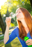 Young Woman Making Bubbles Stock Photos