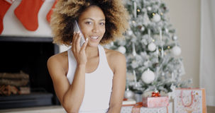 Young woman making a call at Christmas Stock Photos