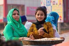 Young woman making chapati during Guru Nanak Gurpurab celebratio Royalty Free Stock Image