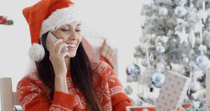 Young woman making a Christmas greeting call Royalty Free Stock Photos