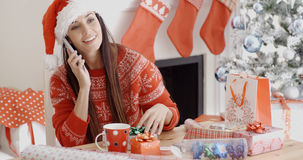 Young woman making a Christmas greeting call Stock Photos