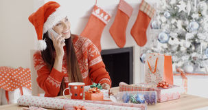 Young woman making a Christmas greeting call Stock Image
