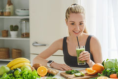 Young woman making detox smoothie at home Stock Photos