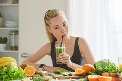 Young woman making detox smoothie at home Royalty Free Stock Photography