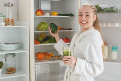 Young woman making detox smoothie at home Royalty Free Stock Photo