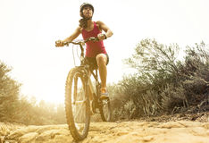 Young woman making downhill with her mountain bike Stock Photo