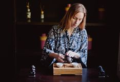 Young women making and drink chinese tea ceremony royalty free stock image