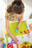 Young woman making easter decoration Royalty Free Stock Photography