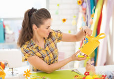 Young woman making easter decoration in studio Stock Photo