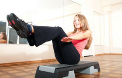 Young woman making exercise in gym Stock Images
