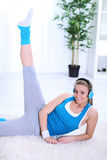 Young woman making exercises at home Royalty Free Stock Photo