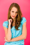 Young woman making faces. Portrait of Young Woman, Standing Over Pink Background Royalty Free Stock Photos