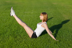 Young woman making fitness exercises Stock Images
