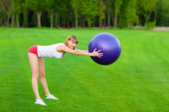 Young woman making fitness exercises Royalty Free Stock Photography