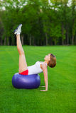 Young woman making fitness exercises Stock Image