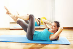 Young woman making fitness exercises stretching Royalty Free Stock Photos