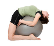 Young woman making fitness on a fitball Stock Image