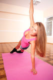 Young woman making flexure exercise Stock Photos