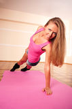 Young woman making flexure exercise Royalty Free Stock Photos