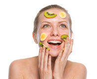 Young woman making fruits mask Royalty Free Stock Image