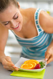 Young woman making fruits plate Royalty Free Stock Photography