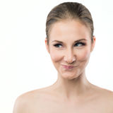 Young woman making funny face expression. Portrait of a young woman making mischievous face expression Royalty Free Stock Photography