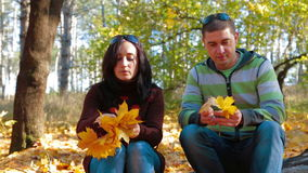 Young Woman Making Garland From Yellow Leaves stock footage