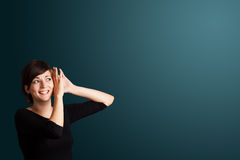 Young woman making gestures Royalty Free Stock Image