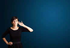 Young woman making gestures Stock Photo