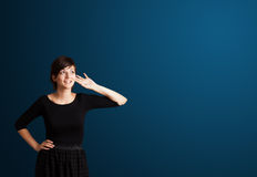 Young woman making gestures Stock Photography