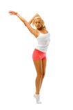 Young woman is making gymnastic exercises Royalty Free Stock Photo