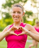 Young woman making a heart gesture Royalty Free Stock Photos