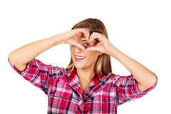Young woman making a heart hand gesture Royalty Free Stock Image