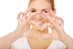 Young woman making heart shape with her hands Stock Image