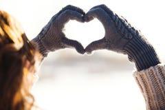 Young woman making heart symbol Royalty Free Stock Photos