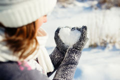 Young woman making heart symbol. With hands, wintertime stock image